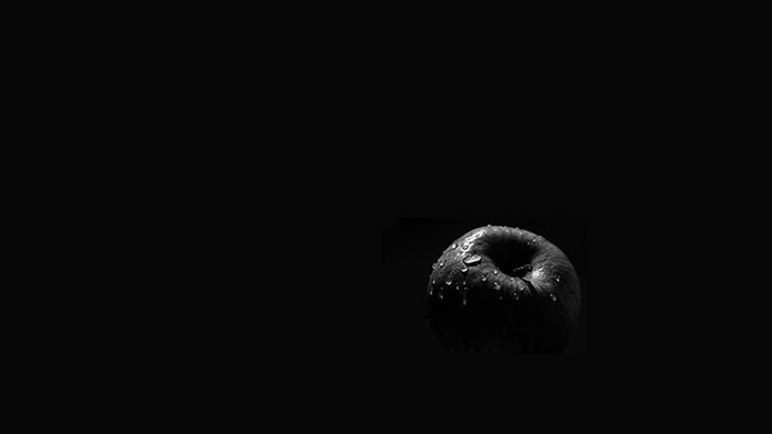 Dark and moody still life of an apple