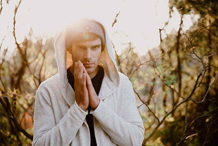 photo of a male model standing outdoors in natural light
