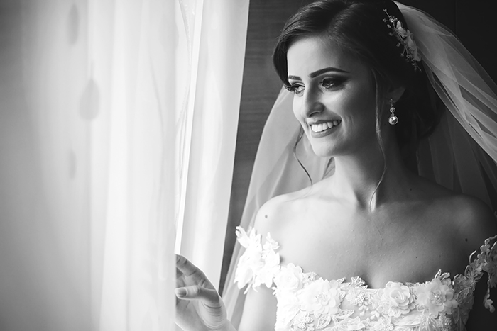 Wedding photo of a bride looking out of the window