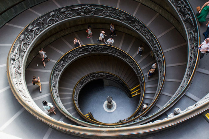 Photo of a spiral staircase with people walking