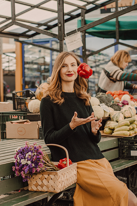 A female model sitting in a market place
