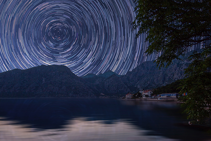 A stunning milky way time lapse above mountains and valley