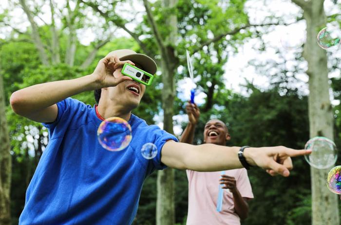A boy using Canon Ivy Rec Outdoor Camera
