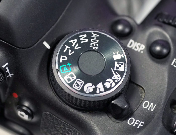 Close up of a digital camera's control dial