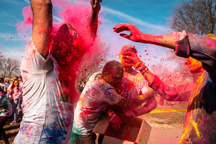 Bright paint thrown in the face of a dancer at a local Holi festival.