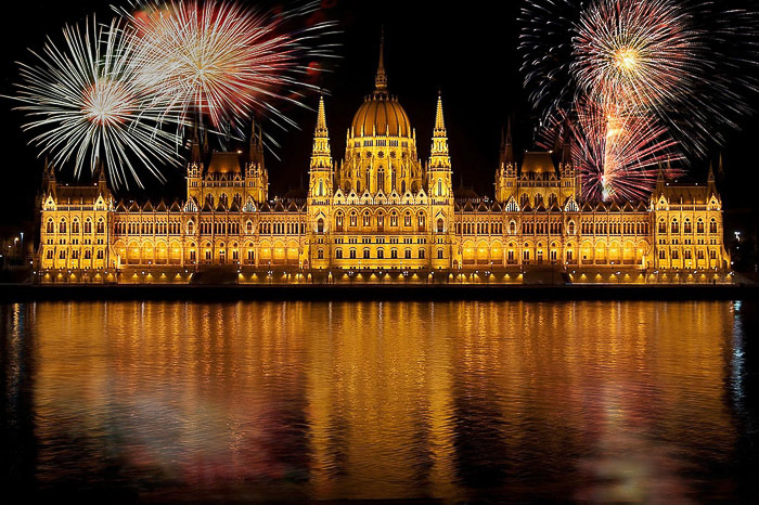 Fireworks exploding over the Hungarian parliament building in Budapest