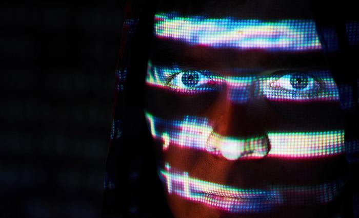 Digital glitch effect portrait of a mysterious man..