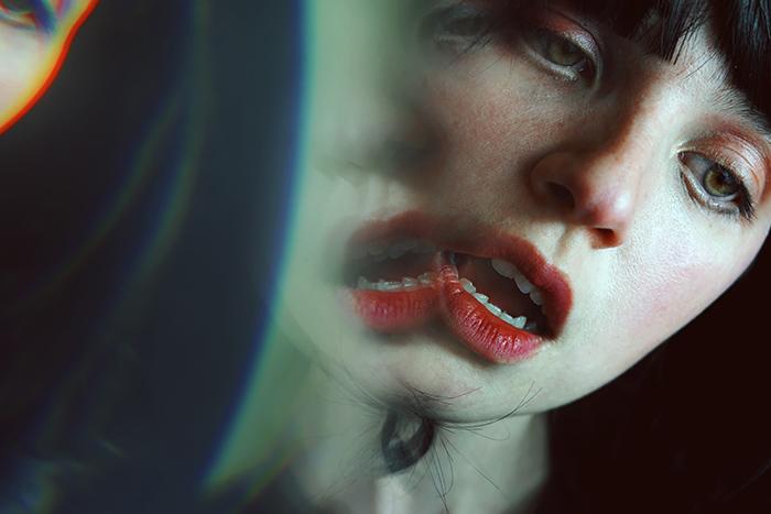 Glitch portrait of a young brunette woman