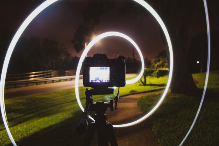 A DSLR recording light spirals at night