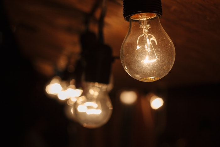 Photo of lightbulbs on a wooden ceiling