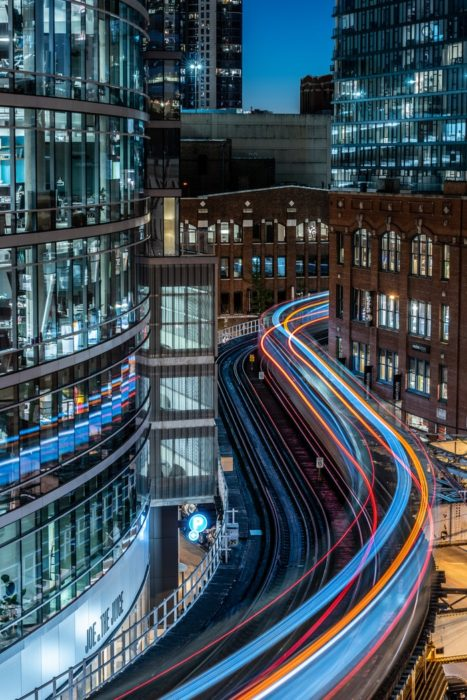A busy night cityscape with streaming light trails