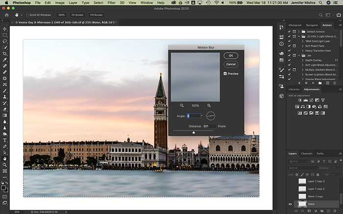 Photoshop screenshot showing water selected on a new layer and applying 201 pixels of motion blur at an 8 degree angle.