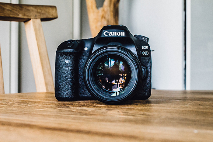 A Canon DSLR camera on a table