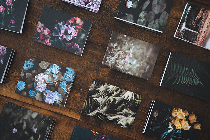 An overhead shot of printed photographs on a table
