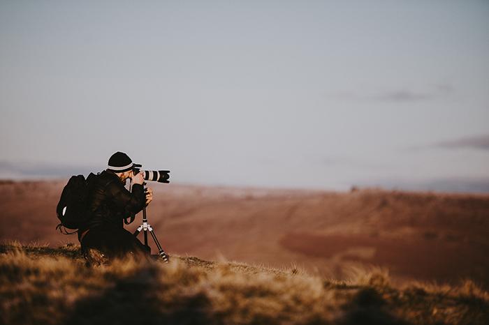 A photographer taking a landscape shot