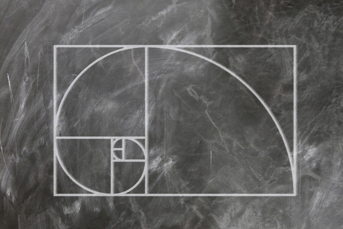 The Fibonacci or golden spiral drawn on a chalk board