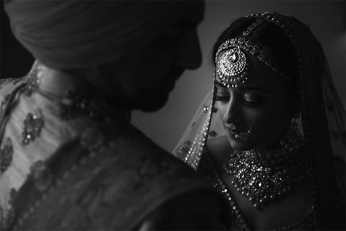 A black and white wedding portrait of an Indian couple