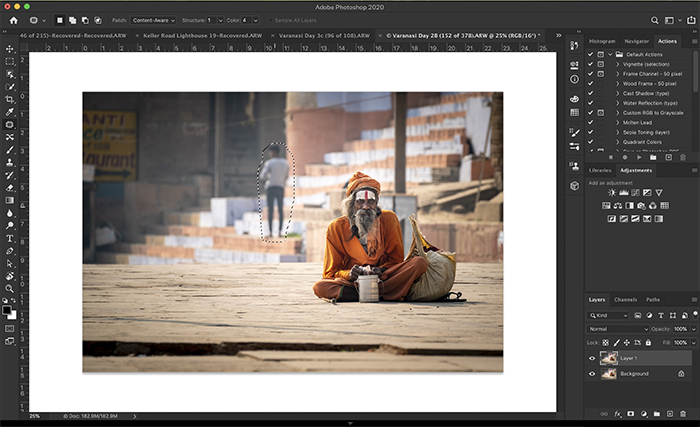 Screenshot of Photoshop workspace showing lasso around person to be removed.