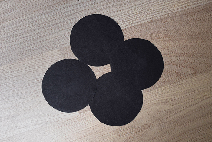 photo of circles cut out of black cardboard