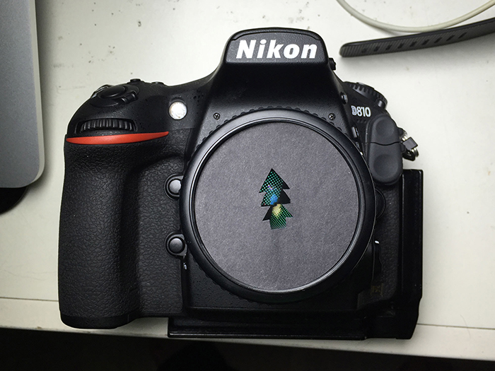 photo of a Nikon camera with a custome bokeh shape filter