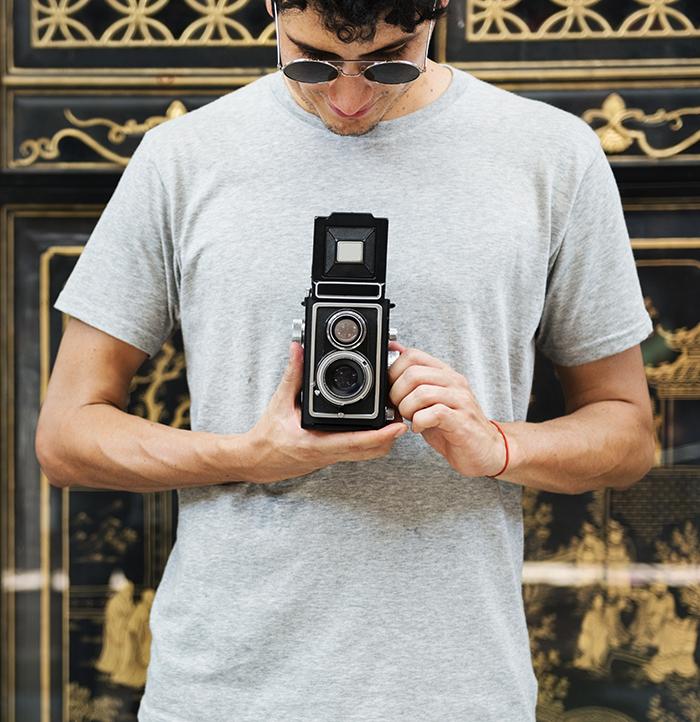 Photographer with an analog camera.