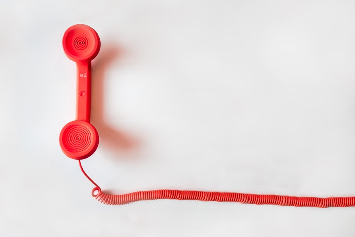 Red telephone on a white background