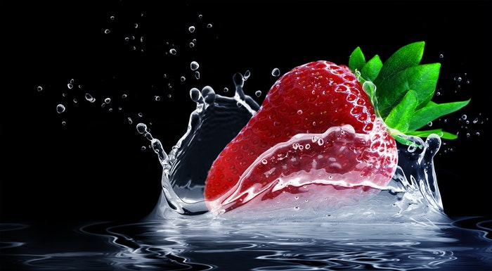 A strawberry splashing in water