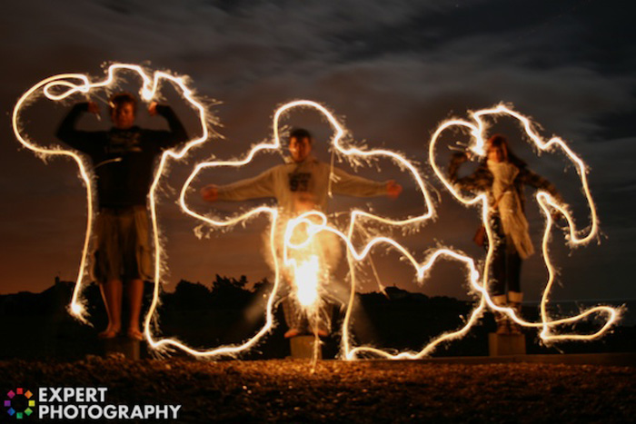 A light graffiti portrait around three men