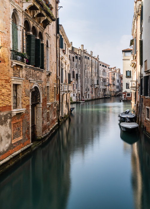 Long exposure image of a canal in Venice, Italy.