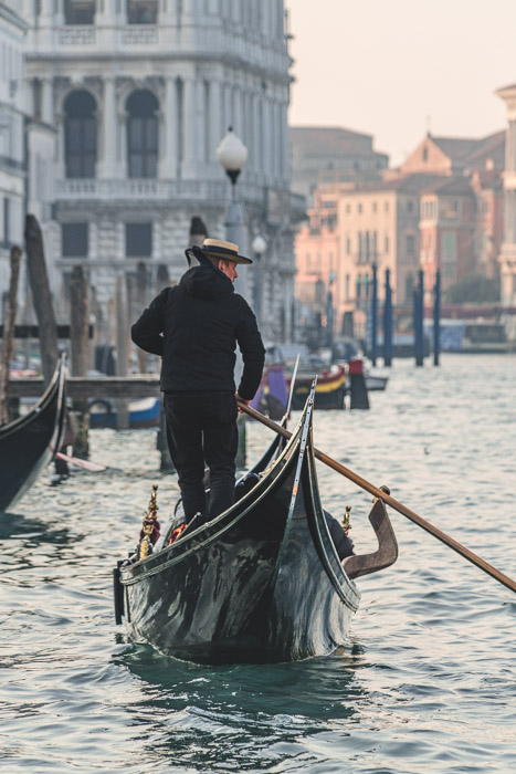 Photo of a man on a gondola in Venice shot using a shallow depth of field