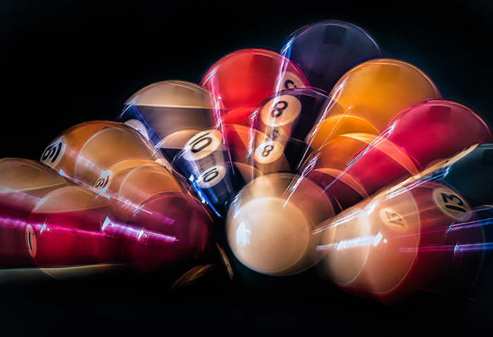Photo of colorful pool balls with slow sync flash