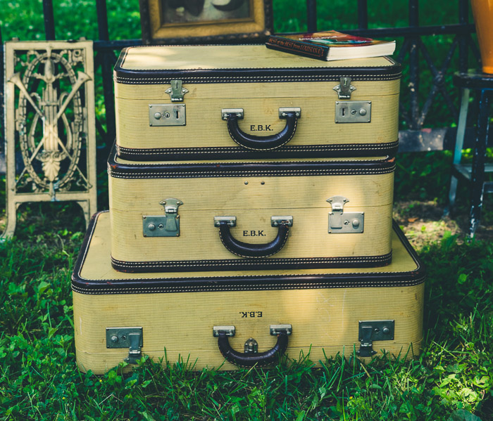 Three suitcases on the grass