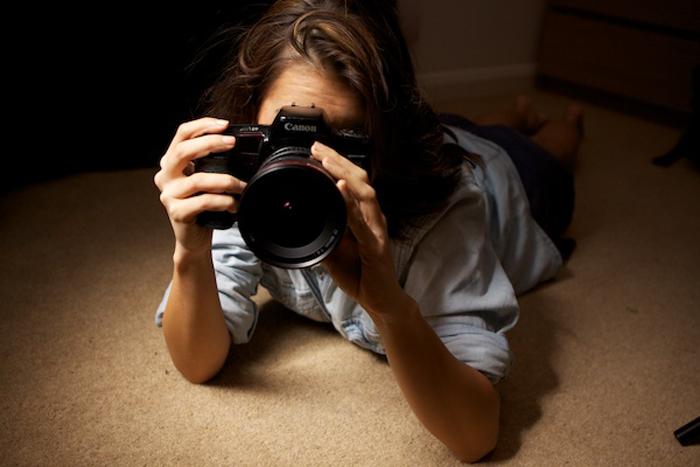 A girl lying down taking a photo