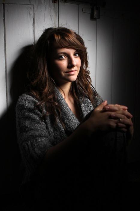A girl posing in low light
