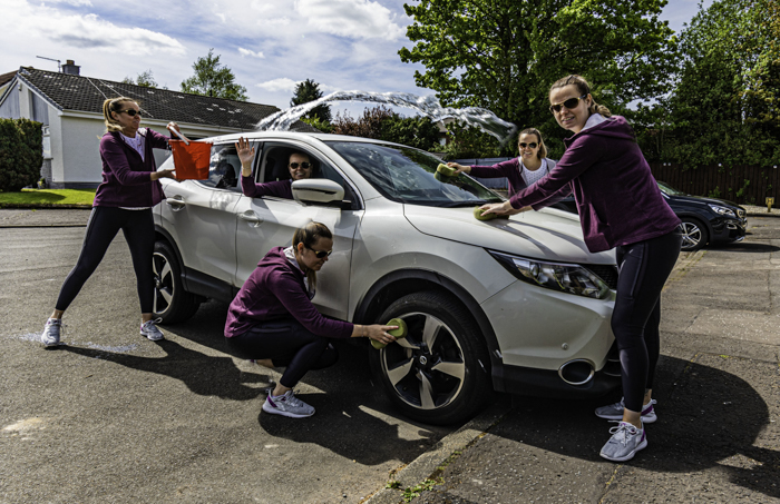 A multiplicity photo of a cloned woman washing her car