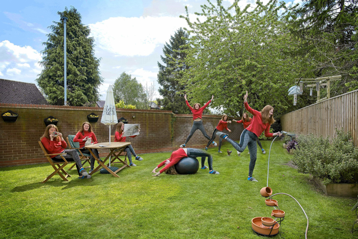 A multiplicity photo of a cloned woman danced around a garden