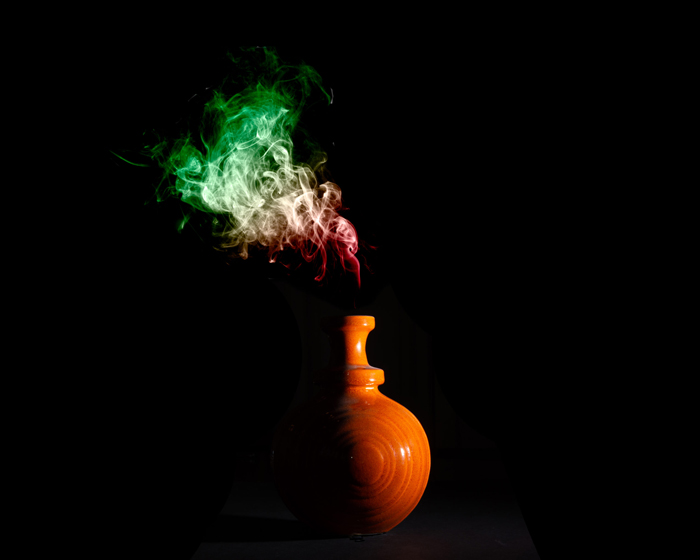 Photo of a vase with smoke coming out of it