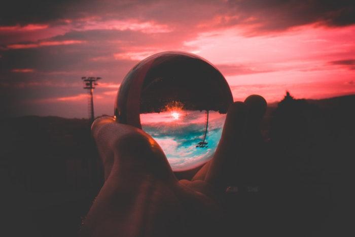 A pink sunset shot through a crystal ball