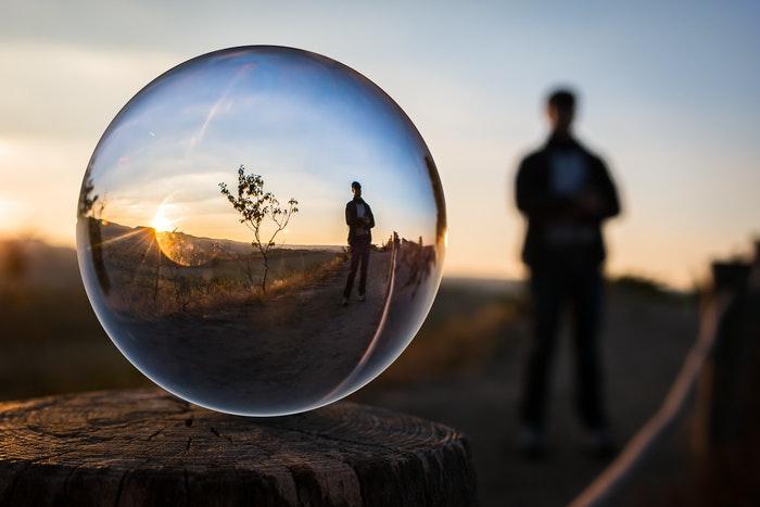 A person shot through a crystal ball