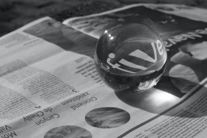 Crystal ball on a newspaper