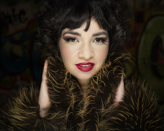 A portrait of a glamorous female model in a fur coat