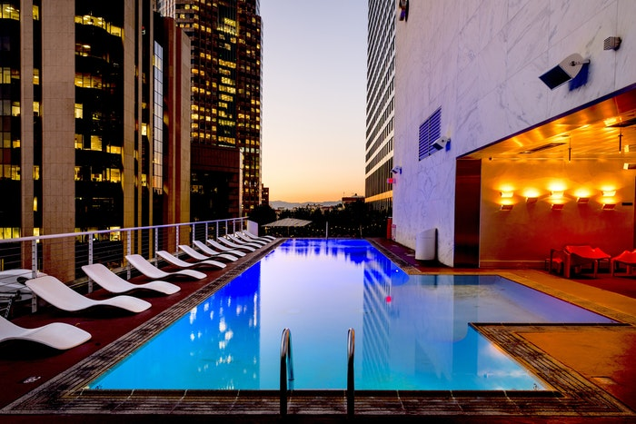 Exterior of a stylish hotel with swimming pool