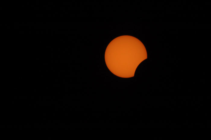 photo of the moon blocking out the sun