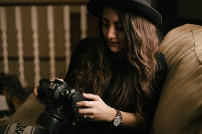 A girl checking photos on a DSLR