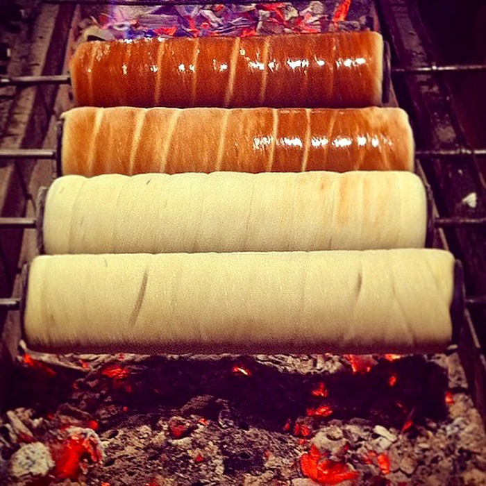 Chimney cakes being cooked on an open fire