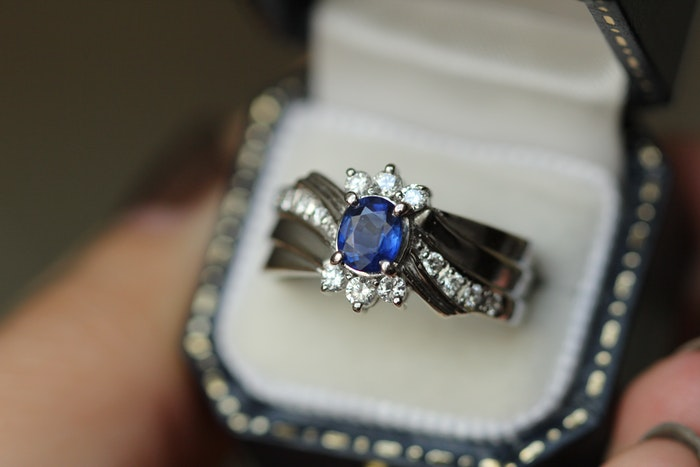 A sapphire ring in a box