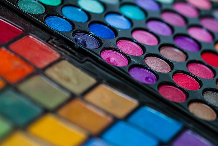 Macro shot of a makeup artist's professional color palette.
