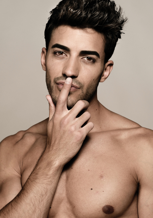 Headshot of a male model posing playfully