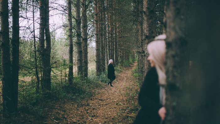 A cloned woman walking in a forest