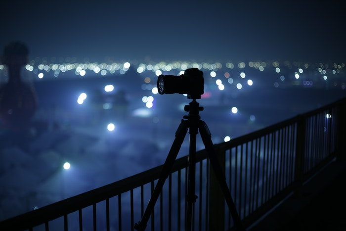 A camera on a tripod at night